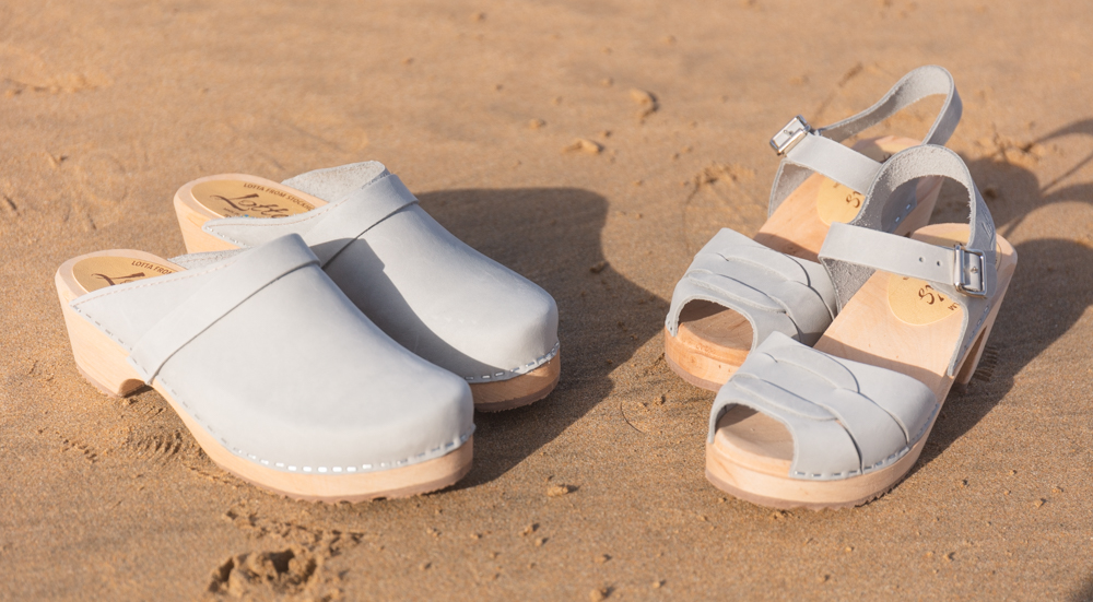 Sea grey clogs on the beach
